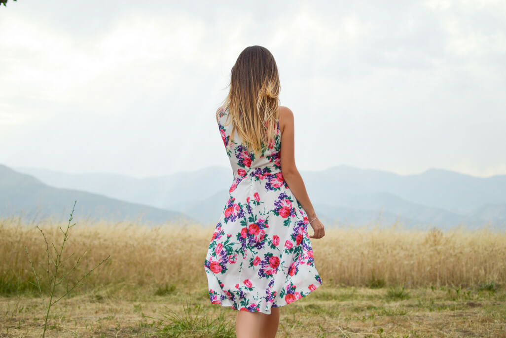 woman in floral dress in a meadow