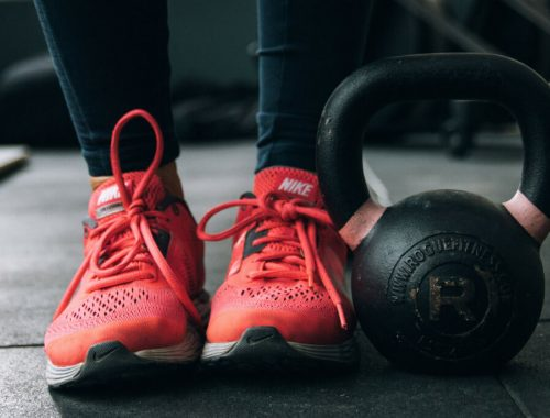 red tennis shoes and kettlebell