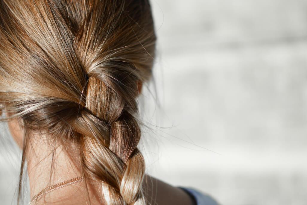 blond hair woman with hair in braid