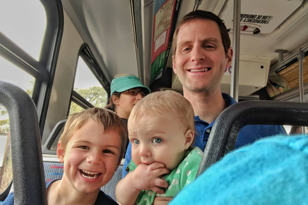 Father with children on the shuttle bus at Grand Canyon National Park