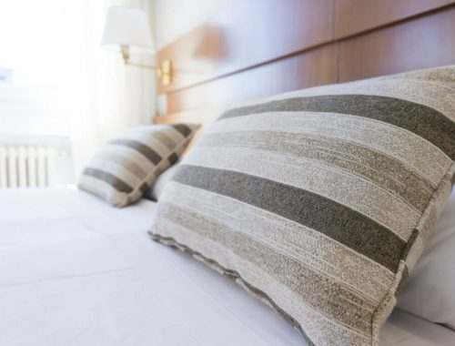 brown striped pillows on a bed