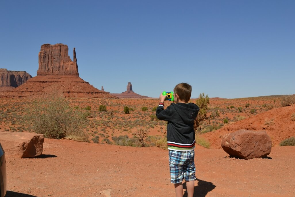 Boy taking a picture at Monument Valley