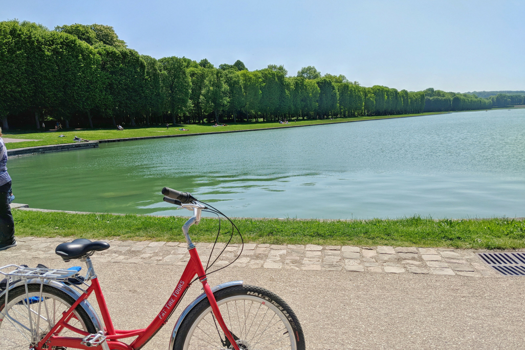 A Weekend in Paris: Red bicycle next to the Grand Canal at Versailles