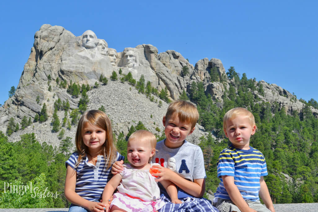 four kids in front of Mt Rushmore in South Dakota