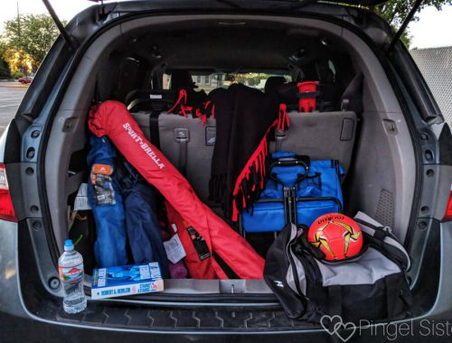 minivan with folding chairs, blanket, wagon, soccer ball, sportbrella