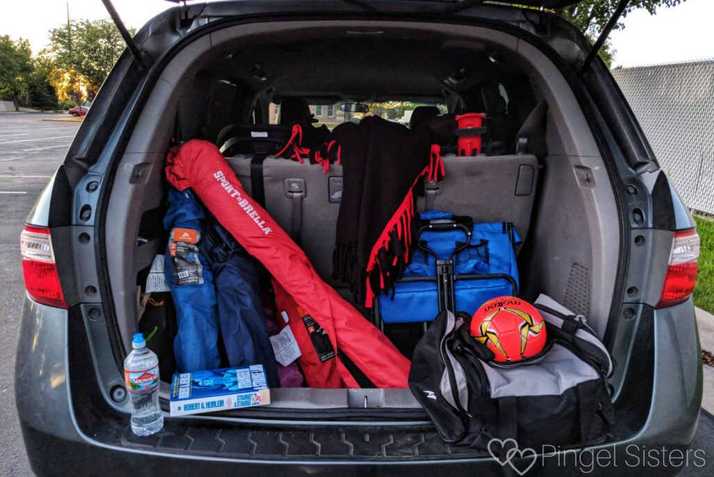 Soccer Mom Essentials: minivan with folding chairs, blanket, wagon, soccer ball, sportbrella