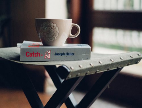 coffee mug, Catch-22 paperback