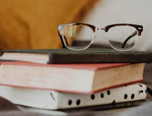 bookstack, yellow pillo, glasses
