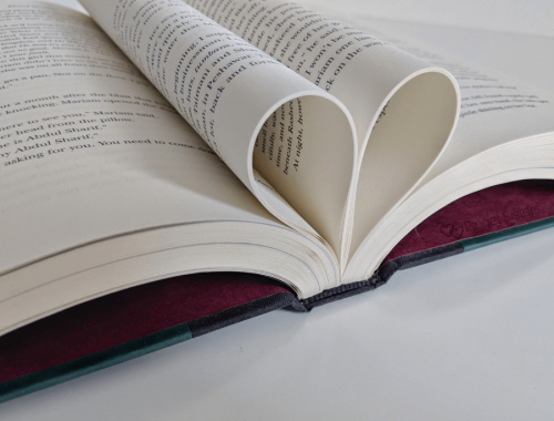 open book making a heart