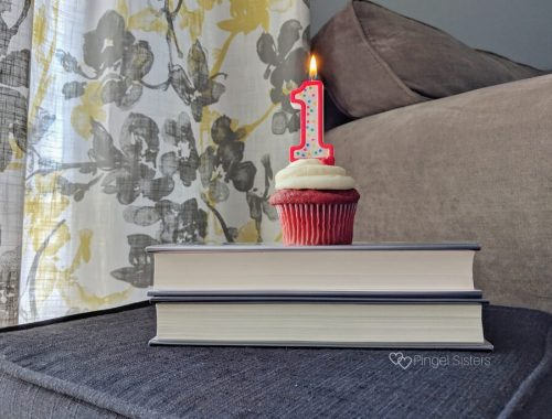 cupcake, number 1 candle, bookstack