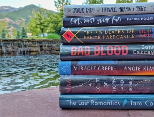book stack The Last Romantics, A Court of Thorns and Roses, Miracle Creek, Bad Blood, The 7 1/2 Deaths of Evelyn Hardcastle, Girl Wash Your Face, Gmorning Gnight